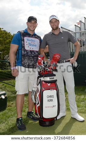 EDISON,NJ-AUGUST 26:Chris Kirk (r) with his Military Caddie during the Barclays Pro-Am held at the Plainfield Country Club in Edison,NJ,August 26,2015. - stock photo