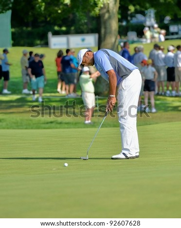 EDISON,NJ AUGUST 26:Golfer Arjun Atwal putts during the second round of the Barclays Tournament held at the Plainfield Country Club on August 26,2011 in Edison,N.J.