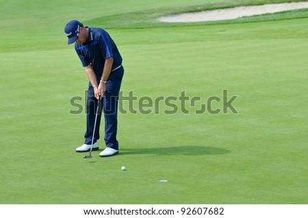 EDISON,NJ-AUGUST 26: Golfer Brian Davis watches his putt during the second round of the Barclays Tournament held at the Plainfield Country Club on August 26,2011 in Edison,N.J. - stock photo