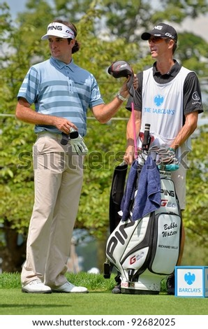 EDISON,NJ-AUGUST 26:Golfer Bubba Watson gets ready at the 1st tee during the second round of the Barclays Tournament held at the Plainfield Country Club on August 26, 2011 in Edison, N.J. - stock photo
