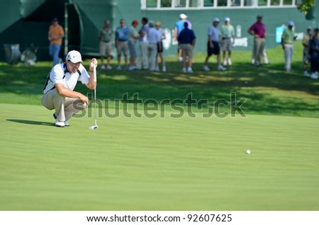 EDISON,NJ-AUGUST 26:Golfer Padraig Harrington lines up his putt during the second round of the Barclays Tournament held at the Plainfield Country Club on August 26,2011 in Edison,N.J. - stock photo