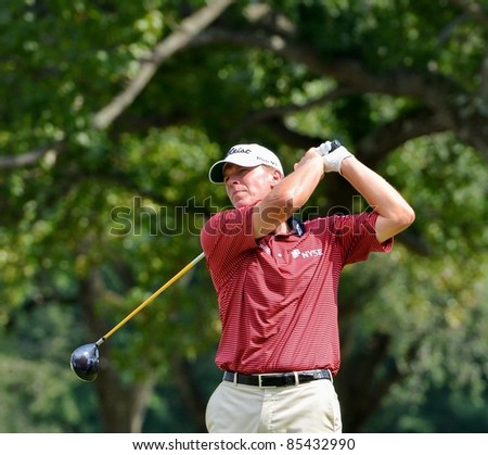 EDISON,NJ-AUGUST 26: Golfer Steve Stricker watches his shot during the second round of the Barclays Tournament held at the Plainfield Country Club on August 26,2011 in Edison,NJ. - stock photo