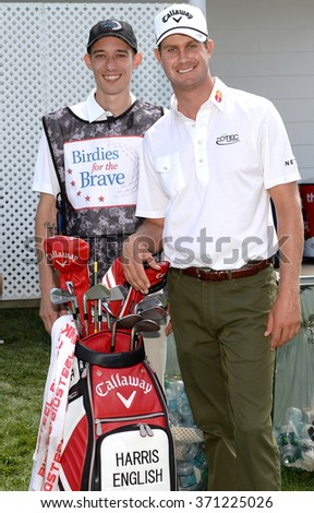 EDISON,NJ-AUGUST 26:Harris English (r) with his Military Caddie during the Barclays Pro-AM held at the Plainfield Country Club in Edison,NJ,August 26,2015.
