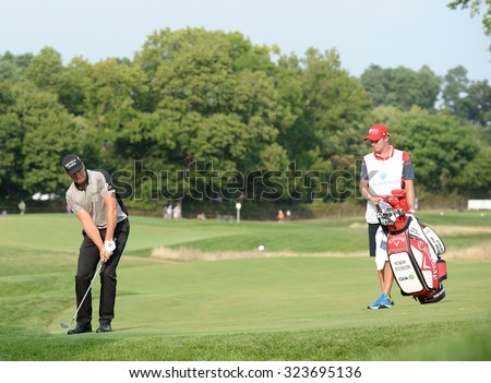 EDISON,NJ-AUGUST 30:Henrik Stenson watches his shot to the 18th hole during the final round of the Barclays Tournament held at the Plainfield Country Club in Edison,NJ,August 30,2015. - stock photo