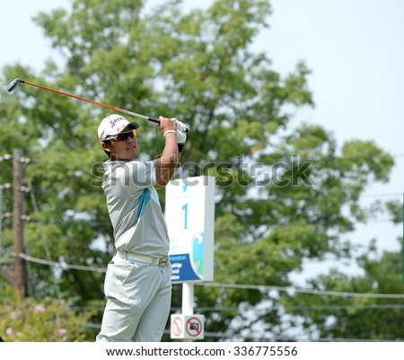 EDISON,NJ-AUGUST 30:Hideki Matsuyama watches his shot from the 1st Tee during the final round of the Barclays Tournament held at the Plainfield Country Club in Edison,NJ,August 30,2015. - stock photo
