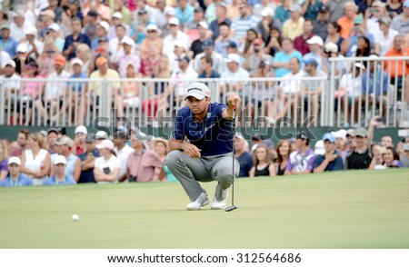 EDISON,NJ-AUGUST 30:Jason Day lines up his final putt on the 18th hole during the final round of the Barclays Tournament held at the Plainfield Country Club in Edison,NJ,August 30,2015.