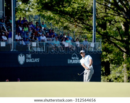 EDISON,NJ-AUGUST 28:Jason day takes a chip shot to the 18th hole during the 2nd round of the Barclays Tournament held at the Plainfield Country Club in Edison,NJ,August 28,2015.