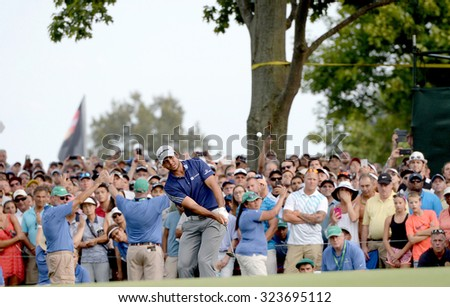 EDISON,NJ-AUGUST 30:Jason Day takes a shot out of the rough to the 18th hole during the final round of the Barclays Tournament held at the Plainfield Country Club in Edison,NJ,August 30,2015. - stock photo
