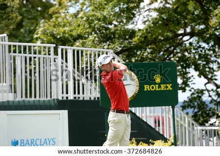 EDISON,NJ-AUGUST 26:Justin Thomas watches his shot during the Barclays Pro-Am held at the Plainfield Country Club in Edison,NJ,August 26,2015. - stock photo