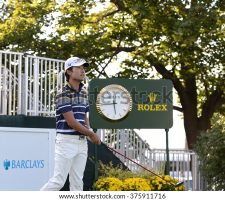 EDISON,NJ-AUGUST 26:Kevin Na watches his shot during the Barclays Pro-Am held at the Plainfield Country Club in Edison,NJ,August 26,2015. - stock photo