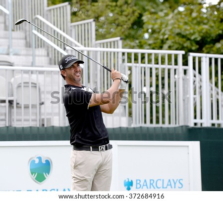 EDISON,NJ-AUGUST 26:Scott Piercy watches his shot during the Barclays Pro-Am held at the Plainfield Country Club in Edison,NJ,August 26,2015. - stock photo