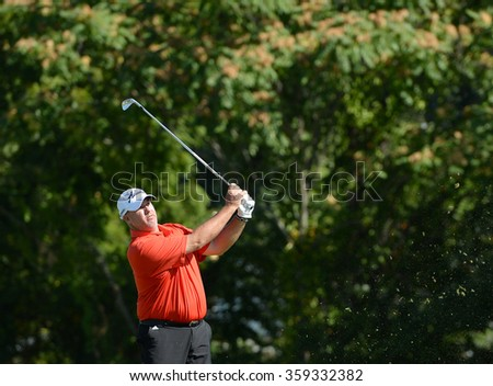 "EDISON,NJ-AUGUST 28:Thomas Brent ""Boo"" Weekley watches his shot during the second round of the Barclays Tournament held at the Plainfield County Club in Edison,NJ,August 28,2015. - stock photo"