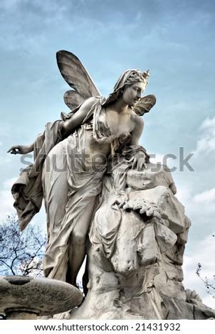 Editorial: Heavenly Angel Sculpture against Deep Blue Sky - stock photo