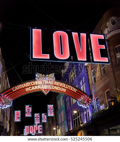 Editorial London, UK - November 27, 2016: Christmas fluorescent decorations in fashionable Carnaby Street in London's West End.