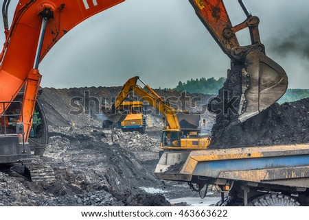 editorial, NOVOKUZNETSK, RUSSIA - JULY 26, 2016: Big yellow mining truck and excavator at worksite
