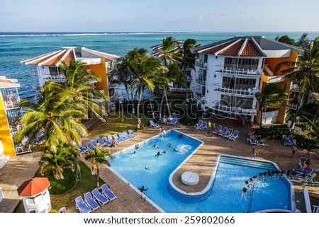 Editorial - San Andres, Colombia, January 9th 2014. Portion of Decameron Aquarium Hotel Resort where we can see the Pool, and a few Hotel with a beautiful view of the Caribbean sea - stock photo