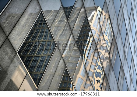 Editorial Use Only: Reflections of Building in Skyscraper Windows (Release Information: Editorial Use Only. Use of this image in advertising or for promotional purposes is prohibited.) - stock photo