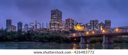 EDMONTON, CANADA - MAY 20: Panorama of Edmonton's skyline  at dusk on May 20, 2016 in Edmonton, Alberta. The Saskatchewan River is in the foreground and a traffic bridge is on the right.