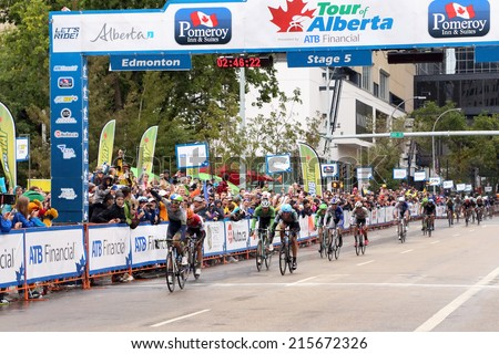 Edmonton, Canada - September 7 2014: Daryl Impey of South Africa crosses the finish line to win stage 5 and the overall title at the Tour of Alberta on September 7 2014 in Edmonton Alberta.