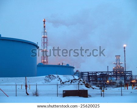 Edmonton's petrochemical refineries process much of the oil sand produced by the Fort McMurray, Alberta open pit mines 440 kms to the north.  These  operate 24/7. - stock photo