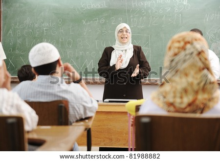 Education activities in classroom at school, happy children learning - stock photo