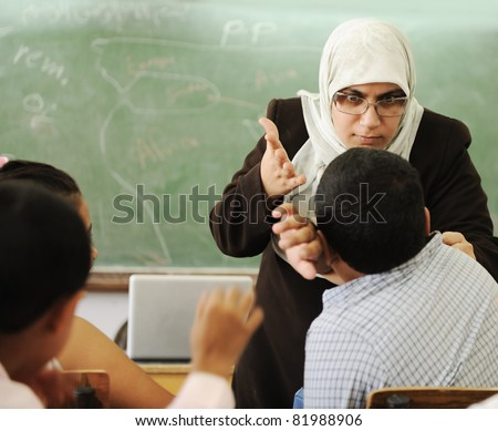 Education activities in classroom,  female teacher yelling at pupil
