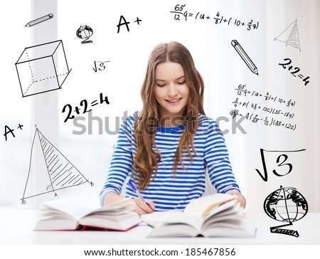 education and home concept - happy smiling student girl with books - stock photo