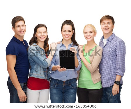 education and modern technology concept - smiling students showing blank tablet pc computer screen