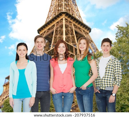 education and people concept - group of smiling students standing - stock photo