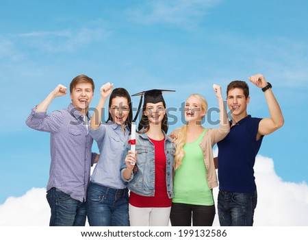 education and people concept - group of standing smiling students with diploma and corner-cap - stock photo