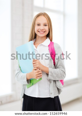 education and school concept - happy and smiling teenage girl - stock photo