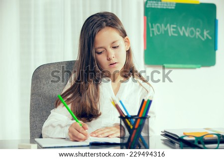 education and school concept - little student girl learn at home - stock photo