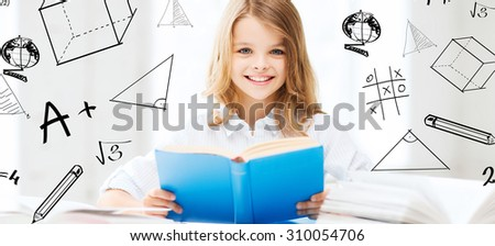 education and school concept - little student girl studying and reading books at school - stock photo