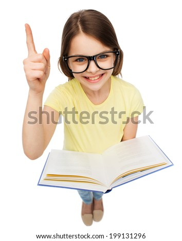 education and school concept - smiling little student girl in eyeglasses with book and finger up - stock photo