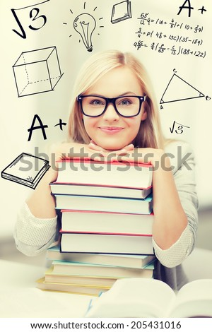 education and school concept - smiling student with stack of books and doodles - stock photo