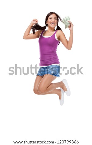 education back to school series - Friendly ethnic Latina woman high school student with pile of 100 dollars money bills in jeans skirt jumping in excitement - stock photo