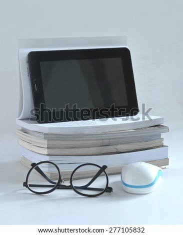 education book and tablet   - stock photo