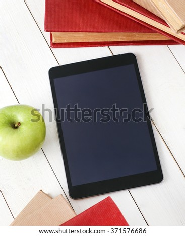 Education. Books with tablet on the table  - stock photo