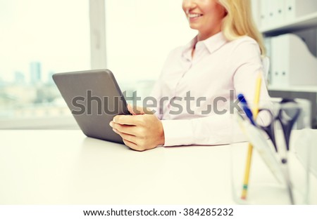 education, business, people and technology concept - close up of smiling businesswoman or student with tablet pc computer in office - stock photo
