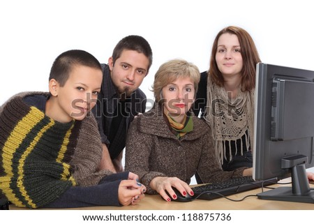 Education, Cheerful Caucasian students and teacher with computer