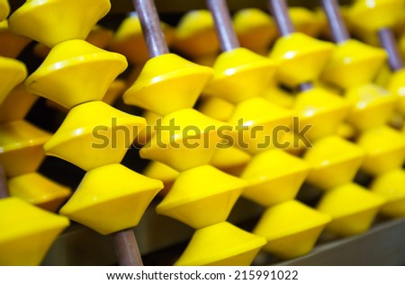 Education concept - Abacus with many yellow beads - stock photo