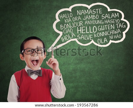 Education concept: Asian school boy learns to speak different languages in a classroom