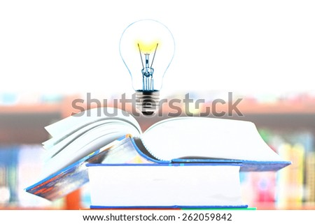 Education concept, book and light bulb - stock photo