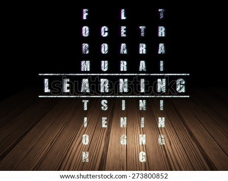 Education concept: Glowing word Learning in solving Crossword Puzzle in grunge dark room with Wooden Floor, black background, 3d render - stock photo