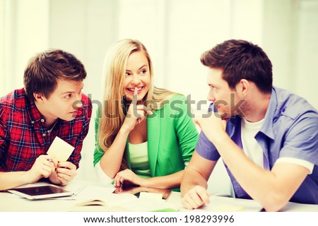education concept - group of students gossiping at school - stock photo