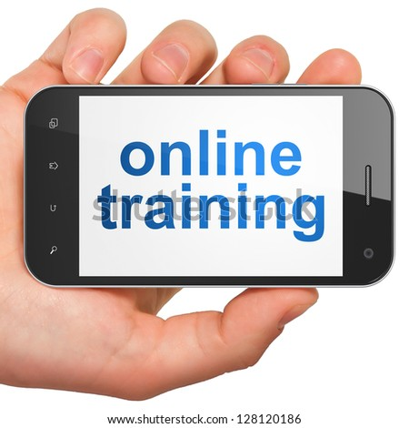 Education concept: hand holding smartphone with word Online Training on display. Generic mobile smart phone in hand on White background. - stock photo