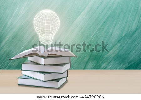 education concept,lamp over open book with green chalkboard.education book concept,education concept background.education concept with lamp   - stock photo
