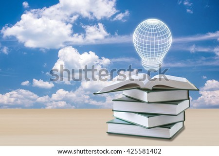 education concept,light box over open book with sky clouds  - stock photo