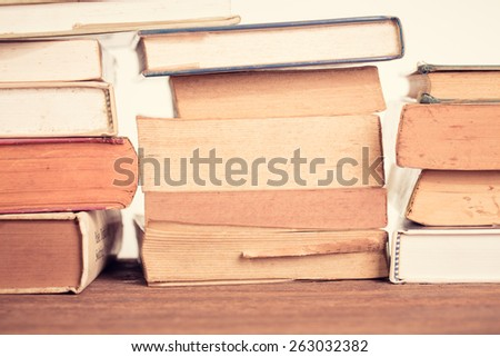 Education concept. Old book background. Vintage filter. - stock photo