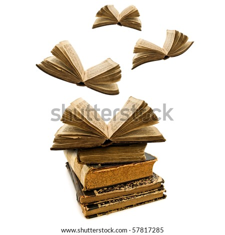 education concept: opened old books flying away - stock photo